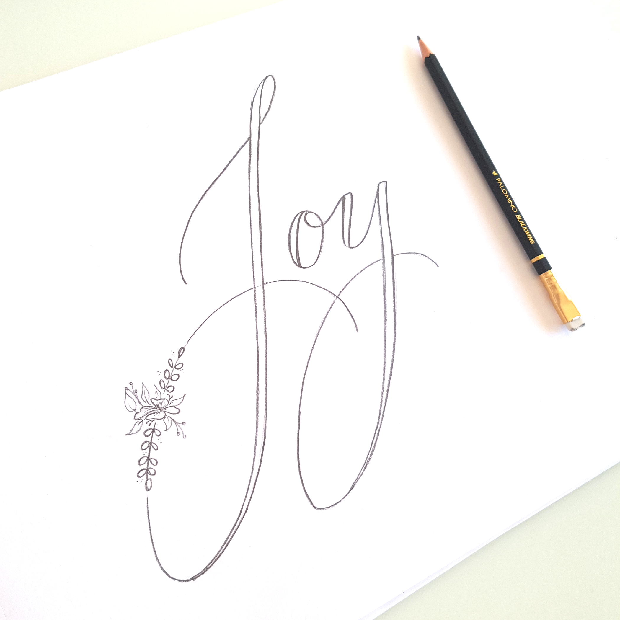 Faux calligraphy pencil sketch before adding ink